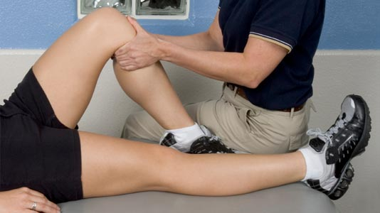 Patient receiving physio treatment on their knee