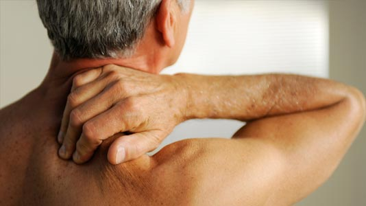 Man feeling his shoulder with pain